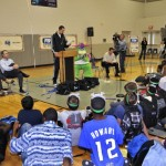 Orlando Magic's Ryan Anderson reads an excerp from the book to Markham Woods Middle School students