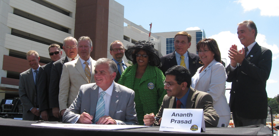 U.S. Department of Transportation Secretary, Ray LaHood (l) signs Full Funding Grant Agreement with FDOT Secretary Ananth Prasad, at kick off of Central Florida's