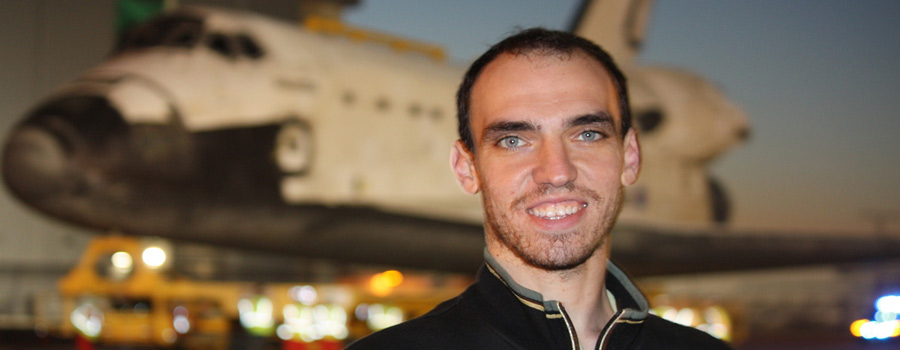 Mike Cantone with Shuttle Atlantis in background.  Cantone covered the final journey of Atlantis on November 3, 2012 (Photo: WONO)