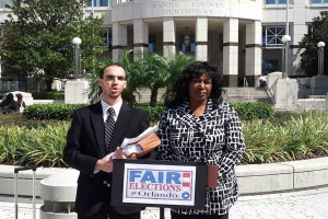 Former municipal candidates Mike Cantone and Lawanna Gelzer call for a criminal investigation into the 2012 Orlando municipal election at a news conference, February 27, 2013. (Photo: WONO)