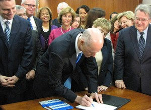Gov. Rick Scott signs sweeping education reform bill at a ceremony on Monday, April 22, 2013 (Photo credit: Brandon Larrabee)