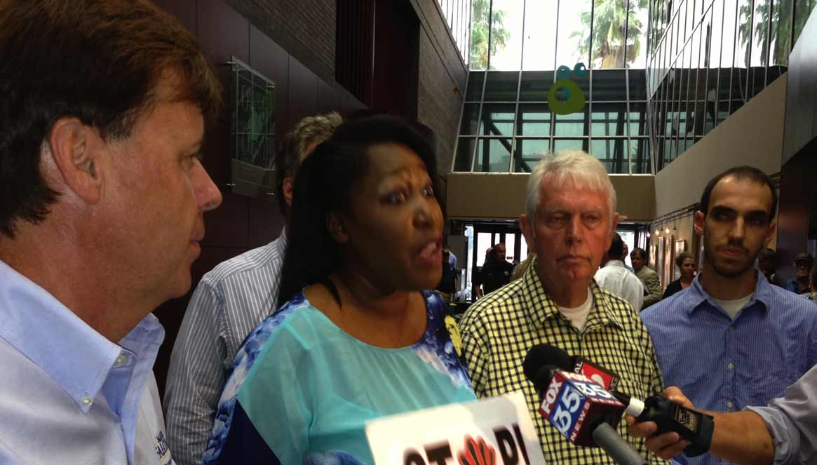 l-r: Matt Falconer, Lewanna Gelzer, Doug Head and Mike Cantone address the media prior to urging the Board of Orange County Commissioners to reject the Orlando Soccer Stadium, July 16, 2013. (Photo: WONO)