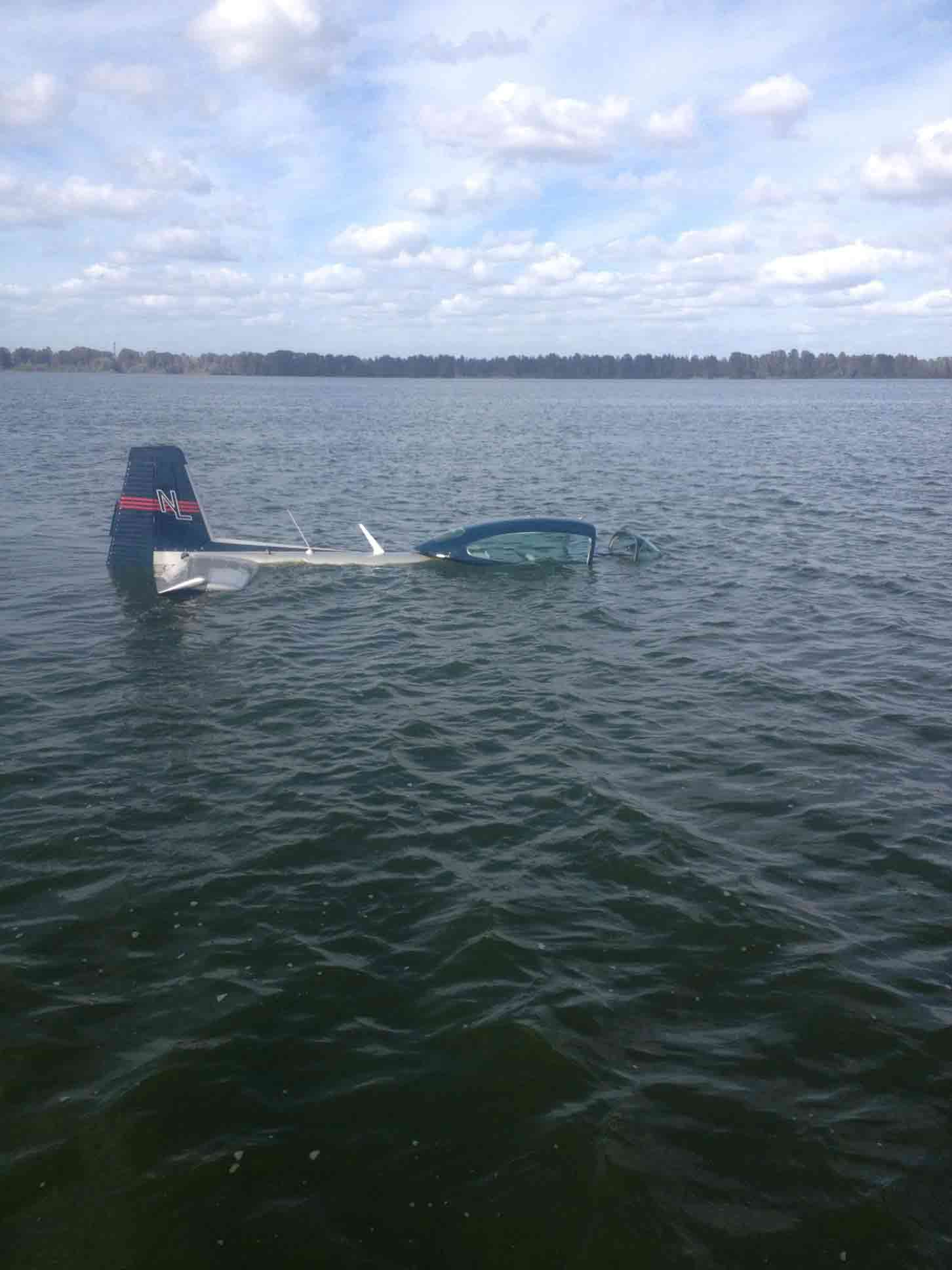 Eric McCoy's plane partially submerged in Lake Hancock
