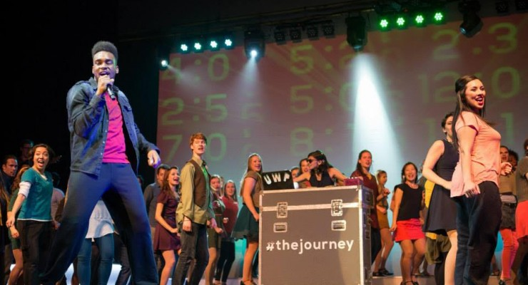 "Sean Wilkins from Orlando, FL singing during a performance of ""The Journey"" with 100 international participants.?"