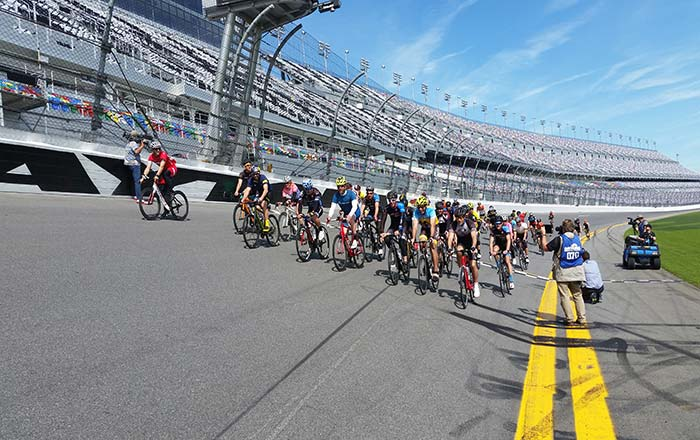 Professional bike racers, triathletes and NASCAR drivers take the final lap at Daytona International Speedway, ending a 60 mile ride that began in St. Augustine in support of bicycle safety.